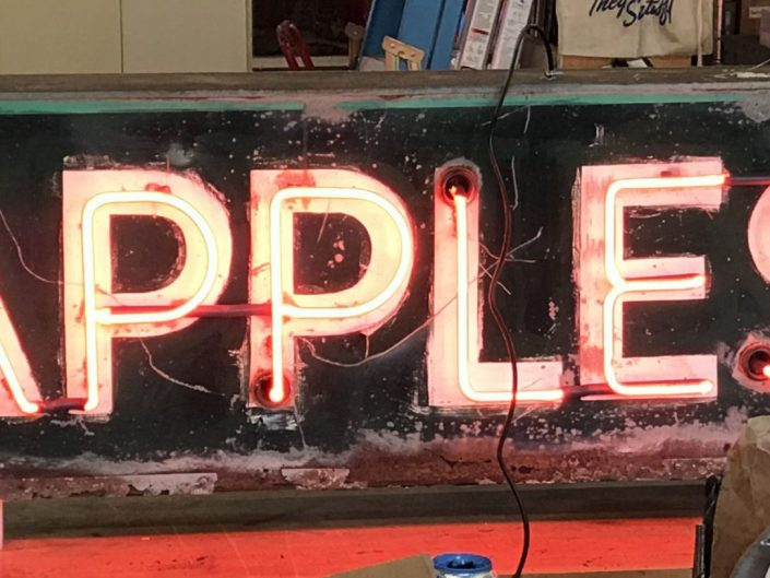 Roachy vintage neon Apple sign