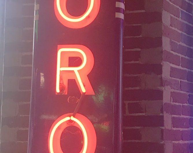 motorola porcelain sign with orange neon